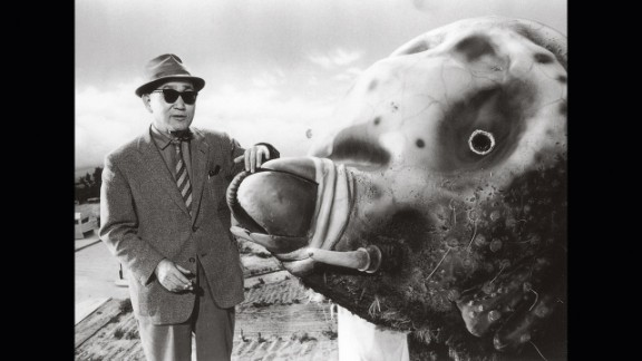 """Tsuburaya and the 33-foot Mothra """"costume"""" in 1961. Note the detailed miniature fields in the background."""