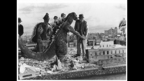 """Tsuburaya supervises an effects scene from 1955's """"Godzilla Raids Again."""" The Godzilla costume was considerably thinner than the one used in the first movie."""