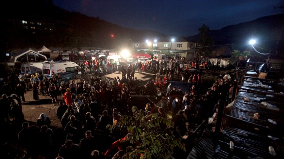 Miners and relatives wait for news outside the mine on May 14.