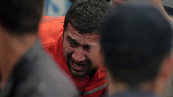 A family member cries as rescue workers carry a survivor from the mine on May 14.