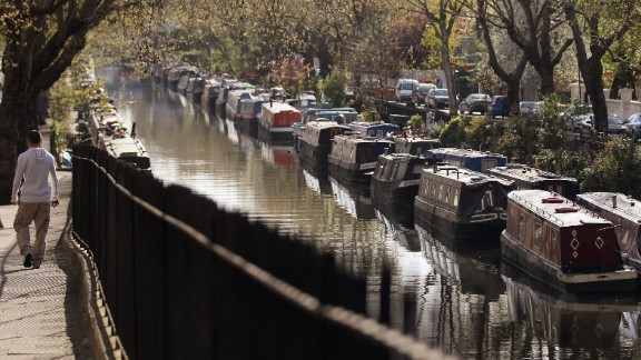 "As real estate prices continue to rise in London, an increasing number of people are turning to the city's waterways. Here, narrowboats line north London's desirable ""Little Venice"" area of Regent's Canal."
