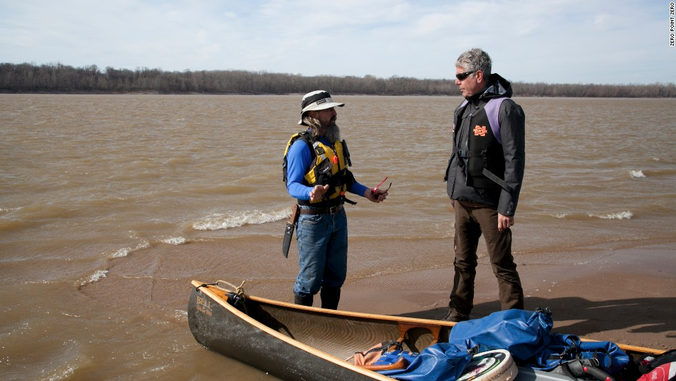 Anthony Bourdain, right, and guide John Ruskey prepare to canoe down the Mississippi River. Bourdain recently went off the beaten path to explore the food and history of the Mississippi Delta.