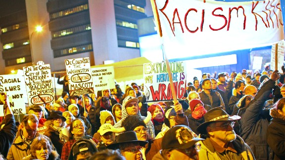 Native Americans protest before the Minnesota Vikings and Washington Redskins game on November 7, 2013