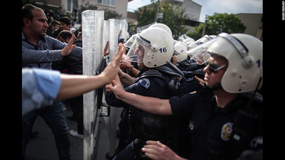 Riot police try to stop protesters attacking the offices of Erdogan's Justice and Development Party in Soma on May 14.