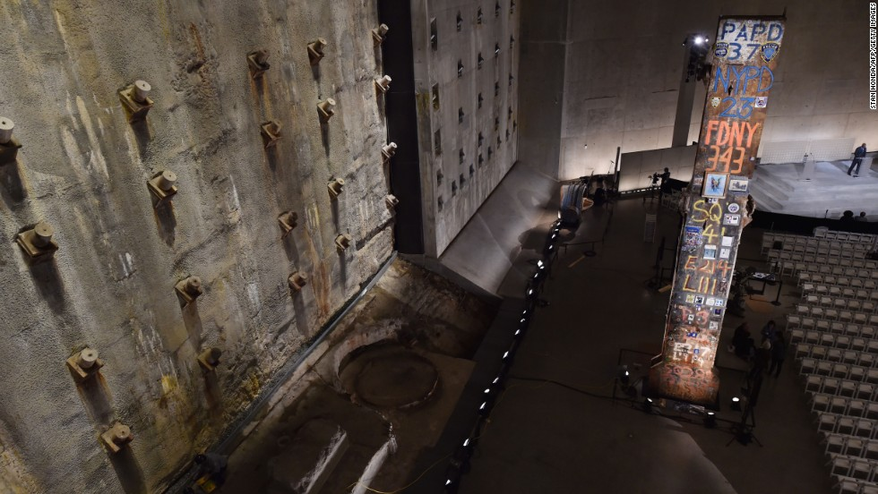 "The symbolic ""Last Column,"" right, a steel beam from one of the towers, stands near the ""slurry wall,"" left, which holds back the Hudson River waters."