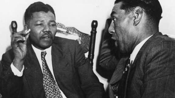 South African resistance leader Nelson Mandela, left, talks to Cape Town teacher C Andrews in 1964. On June 12, 1964, Mandela was sentenced to life in prison for four counts of sabotage. He was released 27 years later, and when apartheid ended he became the country's first black president.