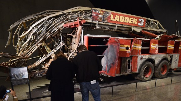 Remains of a New York City Fire Department Ladder Company 3 truck just outside the Historical Exhibition area during a press preview of the National September 11 Memorial Museum at the World Trade Center site May 14, 2014 in New York.