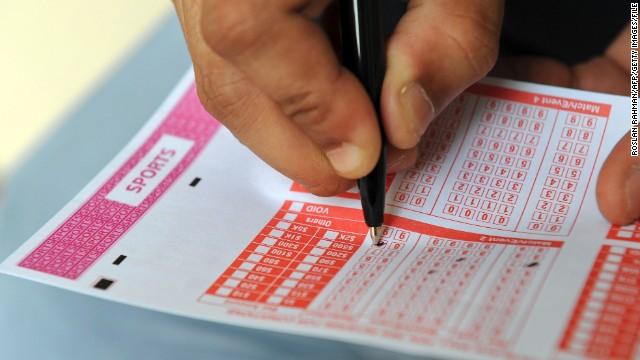This illustration taken on December 10, 2013 shows a person filling out a sports betting slip. It's one of the world's smallest and wealthiest countries, but a deep gambling culture coupled with sheer entrepreneurial zeal has made Singapore a big player in global match-fixing, experts say. AFP PHOTO/ROSLAN RAHMAN (Photo credit should read ROSLAN RAHMAN/AFP/Getty Images