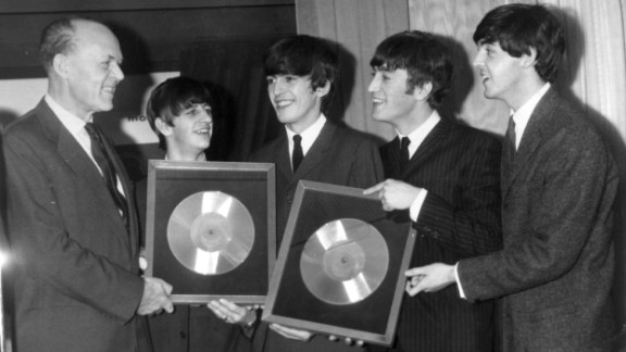 """The Beatles released their first album, """"Please Please Me,"""" in the United Kingdom on March 22, 1963. Here, the band is honored on November 18, 1963, for the massive sales of albums """"Please Please Me"""" and """"With the Beatles."""""""