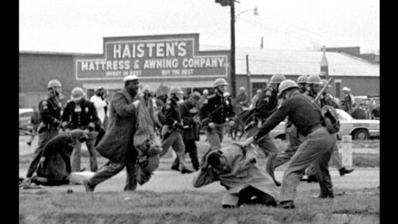 """State troopers swing batons to break up a civil rights voting march in Selma, Alabama, on March 7, 1965. """"Bloody Sunday,"""" as it became known, helped fuel the drive for passage of the Voting Rights Act of 1965."""