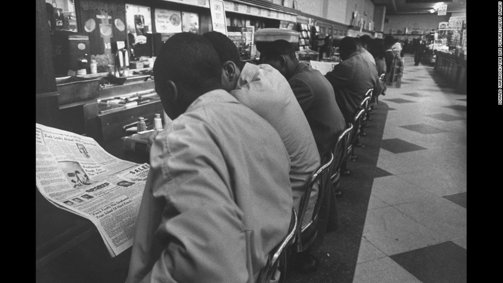 "On February 1, 1960, four African-American college students made history just by sitting down at a whites-only lunch counter at a Woolworth's in Greensboro, North Carolina. Service never came for <a href=""http://www.cnn.com/2011/US/06/07/greensboro.race/"">the ""Greensboro Four,""</a> as they came to be known, and their peaceful demonstration drew national attention and sparked more ""sit-ins"" in Southern cities."