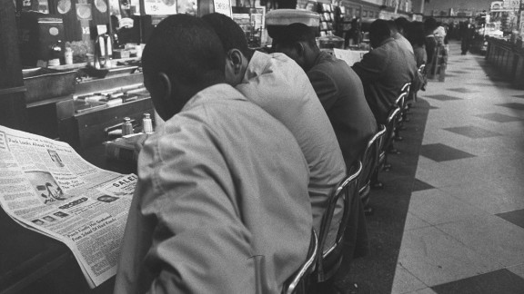 """On February 1, 1960, four African-American college students made history just by sitting down at a whites-only lunch counter at a Woolworth's in Greensboro, North Carolina. Service never came for the """"Greensboro Four,"""" as they came to be known, and their peaceful demonstration drew national attention and sparked more """"sit-ins"""" in Southern cities."""