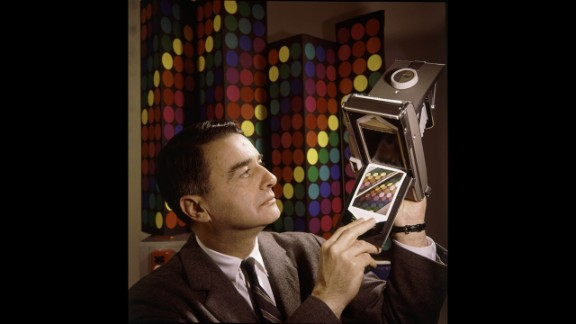 Inventor Edwin Land, president and co-founder of the Polaroid Corporation, demonstrates his company's new instant-color film in 1963.