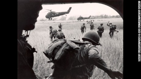 VIETNAM - CIRCA 1965:  US Marines 163rd helicopter Squadron discharging South Vietnamese troops for an assault against the Viet Cong hidden along the tree line in background.  (Photo by Larry Burrows/Time & Life Pictures/Getty Images)
