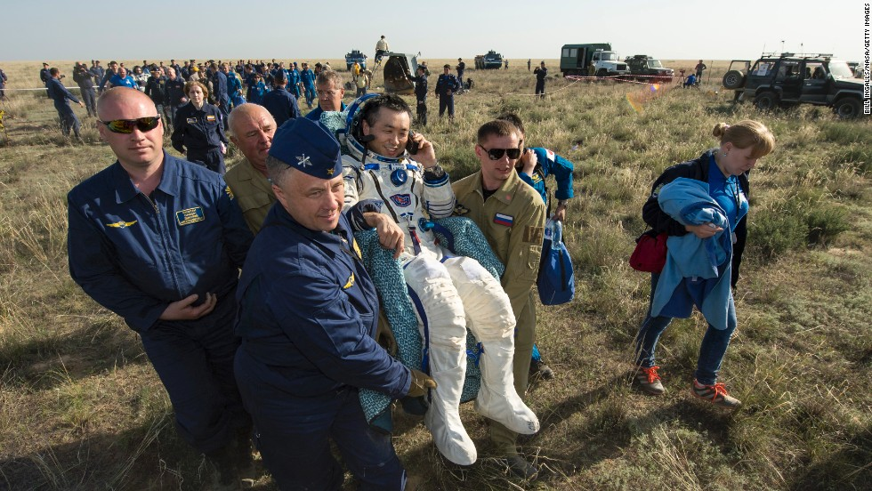 Astronaut Koichi Wakata is carried to a medical tent on Wednesday, May 14, just minutes after he and two others landed in Kazahkstan on their return to Earth. Wakata, Mikhail Tyurin and Rick Mastracchio spent more than six months aboard the International Space Station.