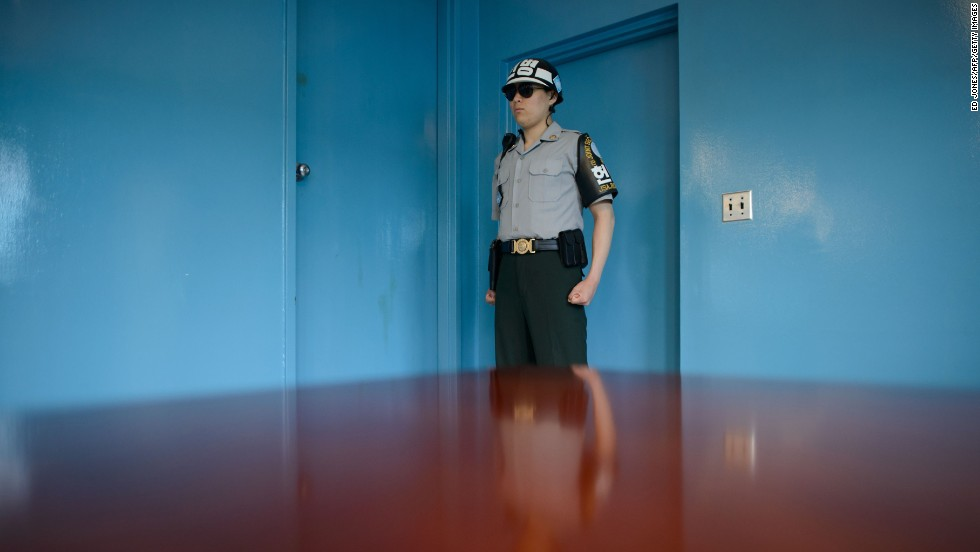 A South Korean soldier stands guard inside a Military Armistice Committee meeting room Wednesday, May 14, at the truce village of Panmunjom, in the demilitarized zone between North and South Korea.