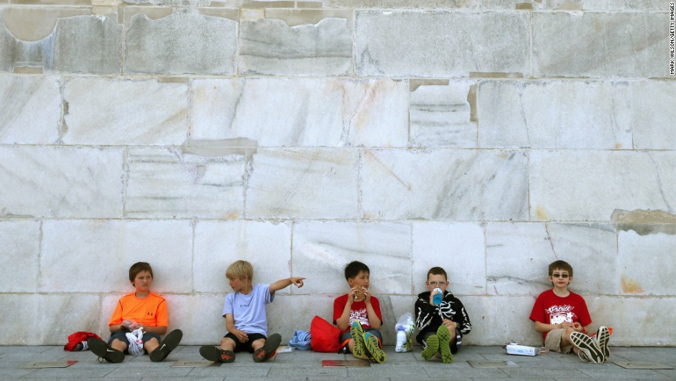 "Fifth-graders have lunch in the shade of the <a href=""http://www.cnn.com/2014/05/12/us/gallery/washington-monument-reopening/index.html"">newly reopened Washington Monument</a> on Monday, May 12. The monument had been closed for repairs after a 2011 earthquake caused $15 million in damage."