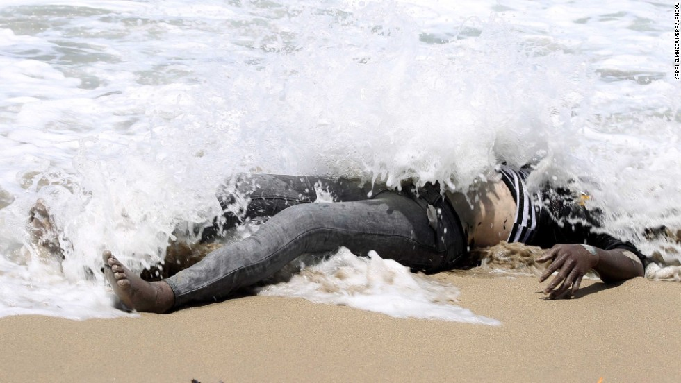 "The body of an illegal migrant lies on the shore of al-Qarboli, Libya, on Wednesday, May 14. Libyan officials said at least 40 people died and around 50 were rescued when a boat carrying mostly sub-Saharan migrants <a href=""http://www.cnn.com/2014/05/11/world/meast/libya-boat-migrants/index.html"">sank off the coast of Tripoli</a> on May 11."