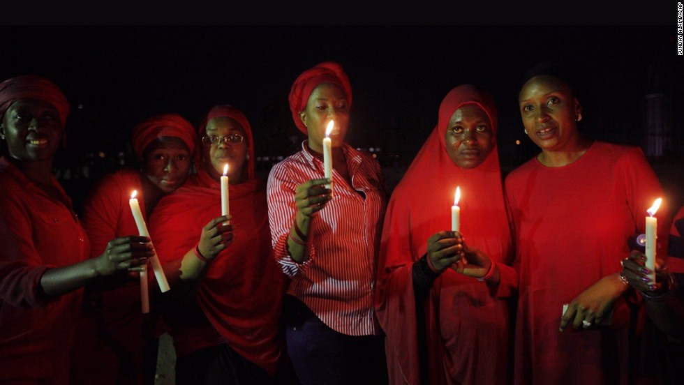 Women in Abuja hold a candlelight vigil on Wednesday, May 14, one month after the schoolgirls were kidnapped.