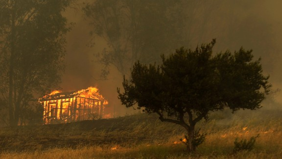 Fire engulfs a structure in Escondido, California, on Thursday, May 15.