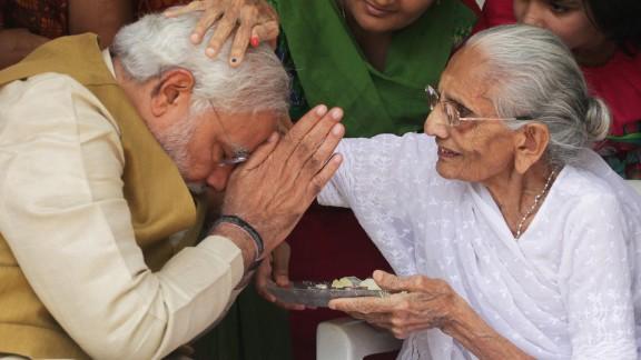 Hiraben Modi, 90, blesses her son Narendra, who becomes India