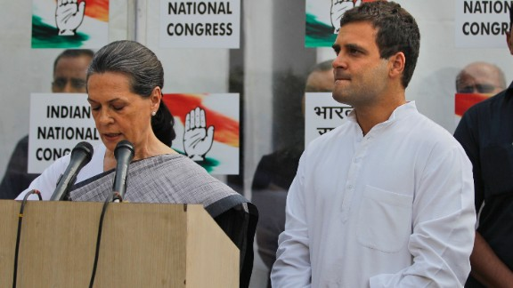 Sonia Gandhi, leader of the Indian National Congress, addresses reporters May 16 outside party headquarters in New Delhi, with her son and party Vice President Rahul Gandhi at her side. Rahul Gandhi said he took responsibility for the defeat of the Congress party, which had dominated Indian politics since the nation