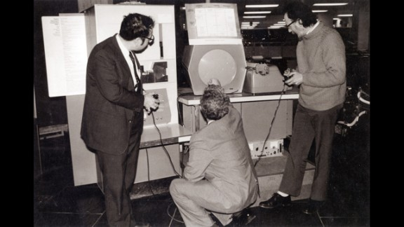 """In 1962, Massachusetts Institute of Technology students Steve Russell, Martin """"Shag"""" Graetz and Alan Kotok created """"Spacewar!"""" which is widely considered the first interactive video game. Dueling players fired at each other's spaceships using early versions of joysticks. This photo shows the three """"Spacewar!"""" inventors playing the game at Boston's Computer Museum in 1983."""
