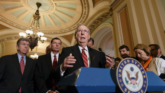 Senate Minority Leader Mitch McConnell of Ky., joined by, from left, Sen. Roy Blunt, R-Mo., and Sen. John Barrasso, R-Wyo., speaks to reporters on Capitol Hill in Washington, Tuesday, May 13, 2014, after a Republican caucus. (AP Photo)