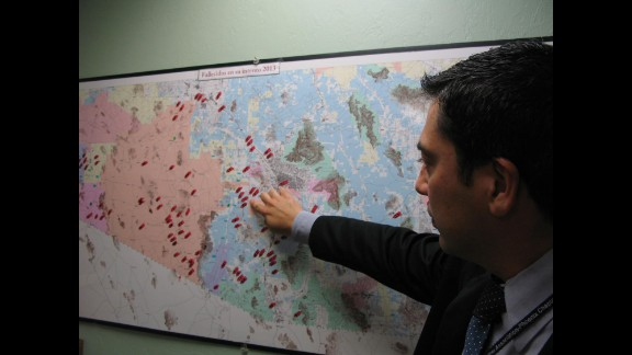 """The Arizona desert is a common crossing place for migrants traveling to the United States from Mexico. An alarming number perish along the way, creating what some investigators have called """"a humanitarian crisis at the border."""" Jeronimo Garcia helps identify corpses for the Mexican Consulate in Tucson. Each red dot on this map shows a death in the desert."""