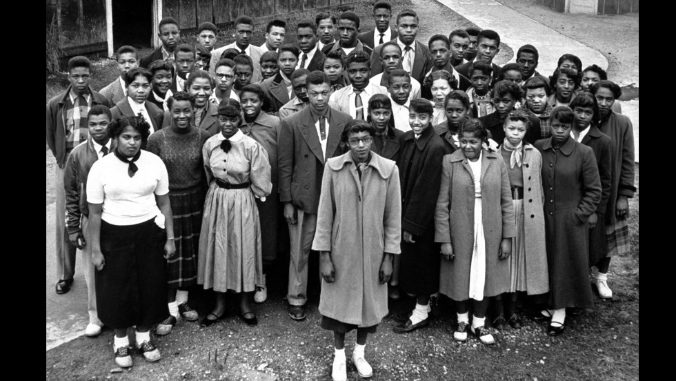 Among the other cases attached to Brown v. Board of Education was Dorothy Davis, et al. v. County School Board of Prince Edward County, Virginia. Pictured are some of the more than 100 students named in that case. The lawsuit initially sought repairs to Robert Moton High School, a segregated school in Farmville, Virginia. The suit was named for Dorothy E. Davis, pictured in the center with glasses.