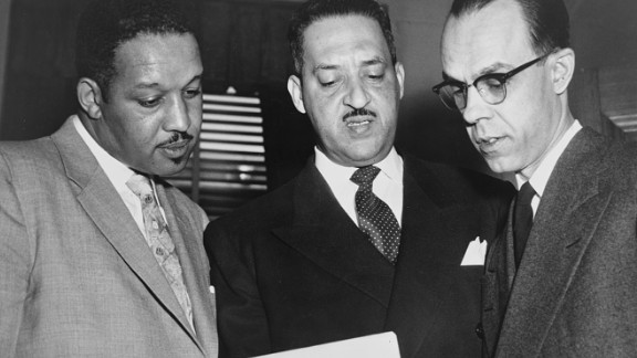 Harold P. Boulware,Thurgood Marshall, and Spottswood W. Robinson III confer at the Supreme Court prior to presenting arguments against segregation in schools during Brown v. Board of Education case.  After the initial overturning of the Kansas lawsuit, it was combined with