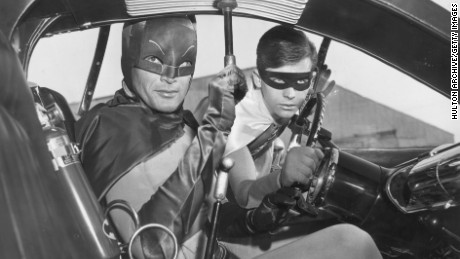 1966:  Actors Adam West (left) and Burt Ward as Batman and Robin in the Batmobile in a still from the television series, 'Batman'.  (Photo by Hulton Archive/Getty Images)
