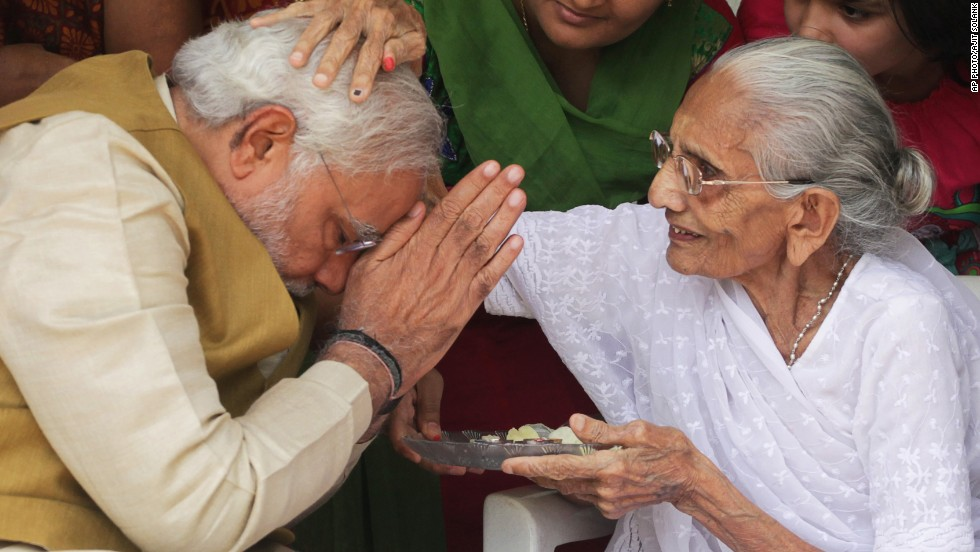 "MAY 16 - GUJARAT, INDIA: 90-year-old Hiraben blesses her son and India's next Prime Minister Narendra Modi at her home in Gandhinagar. Analysts are predicting a marked change in direction for the world's most populous democracy as<a href=""http://cnn.com/2014/05/16/world/asia/india-election-result/index.html""> Modi claims victory</a> for his Hindu nationalist BJP party in the largest election in history."