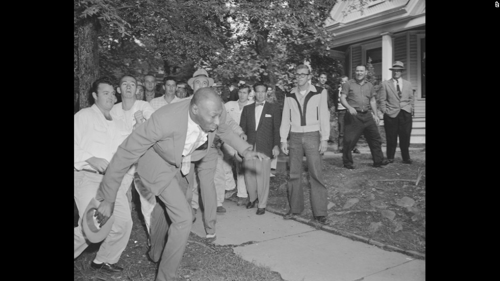 Alex Wilson, a reporter from the Tri-State Defender, is shoved by an angry mob of white people near Central High School in Little Rock, Arkansas, on September 23, 1957. The fight started when nine black students gained entrance to the school as the U.S. Army enforced integration.