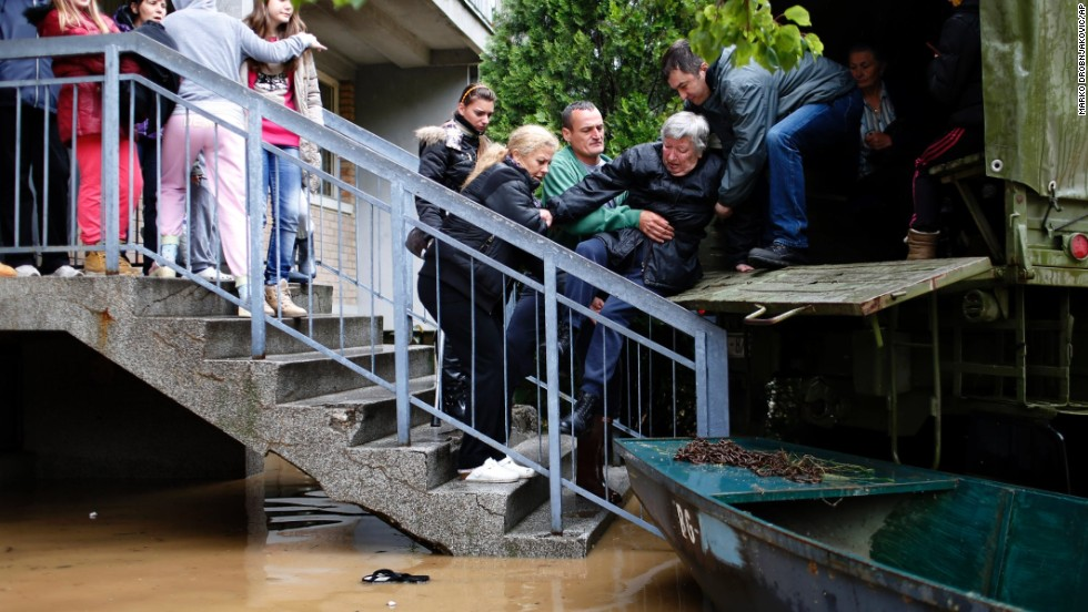 People flee their homes in Obrenovac on May 16.
