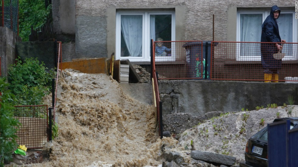 A man works to divert a stream of water from his home near Zenica, Bosnia-Herzegovina, on May 15.