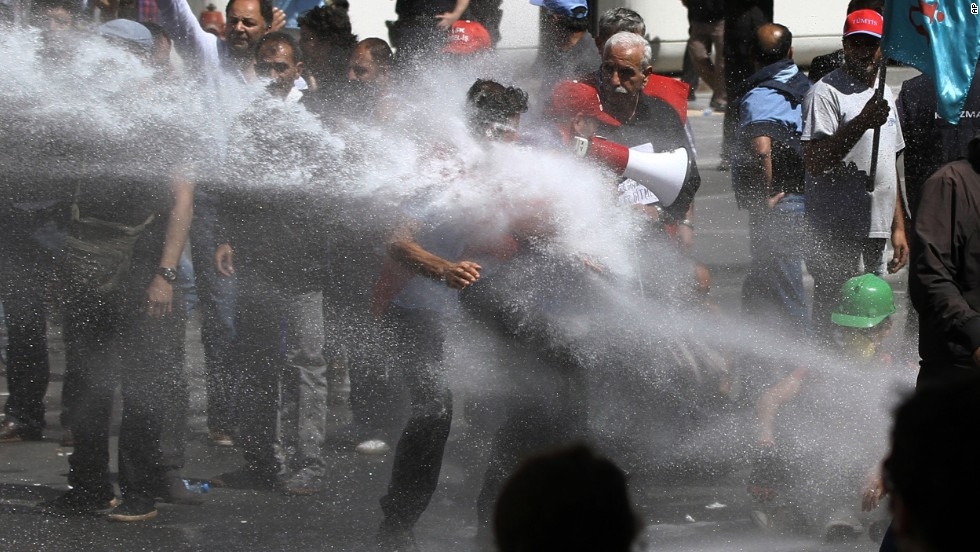 Police use water cannons and tear gas to disperse people gathered to commemorate victims and protest the government's labor policy in Izmir, Turkey, on May 16.