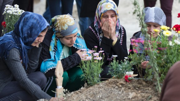 Friends and relatives of dead miners pray at a cemetery on Saturday, May 17.  The search for victims of this week's coal mine fire in Soma is now over, with a final death toll of 301, Turkish government officials said Saturday.