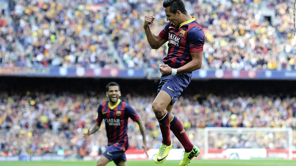Alexis Sanchez (right) celebrates after scoring the opening goal for Barcelona, raising home hopes of a fifth title in six years.