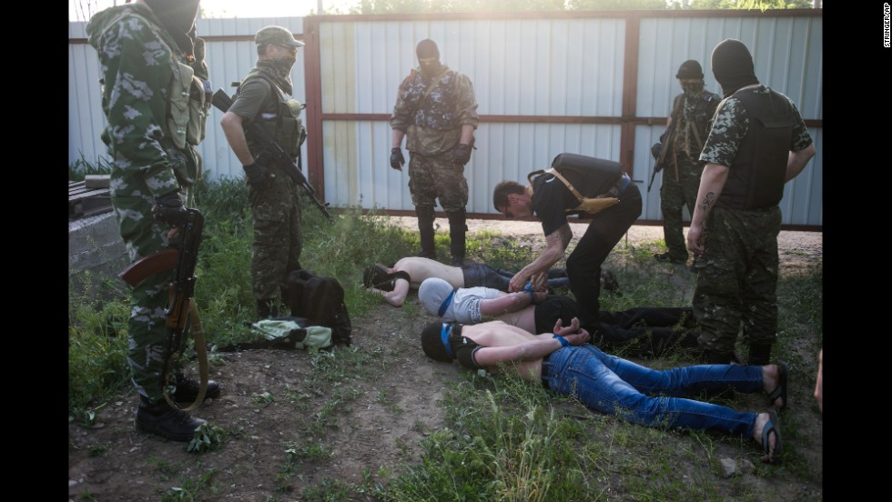 Pro-Russian militants detain three men on Sunday, May 18, in Kramatorsk, Ukraine. The men are suspected of spying for the Ukrainian government.