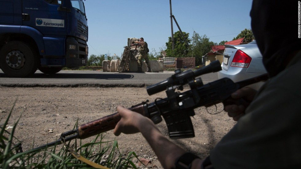 Pro-Russian militants guard a checkpoint outside Slovyansk on Saturday, May 17.