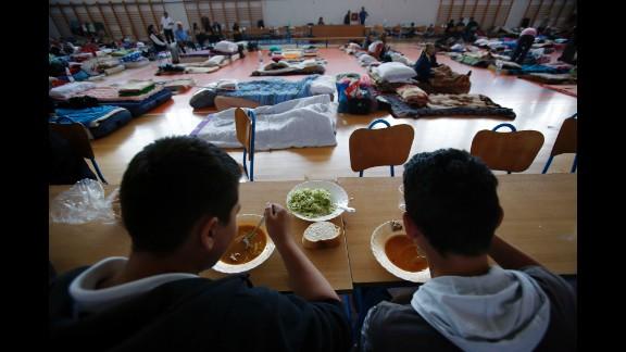 People take shelter at a sports center in Odzak, Bosnia-Herzegovina, on May 19.