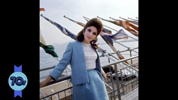 """Italian actress Gina Lollobrigida contrasts a demure powder blue suit with racy lace on top at Cannes in 1972. She starred in films such as """"The Hunchback of Notre Dame"""" (1956) but as her career slowed, she established herself as a photojournalist and sculptor, even gaining an exclusive interview with Communist dictator Fidel Castro."""