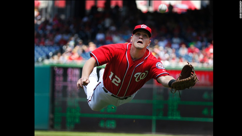 Washington Nationals first baseman Tyler Moore makes a diving catch during a home game against the New York Mets on Sunday, May 18. The Nationals won the game 6-3 to take two of three in the weekend series.