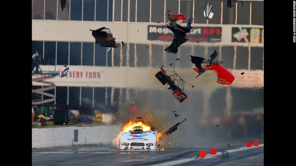 An engine explodes on the funny car of NHRA driver Jack Beckman, sending pieces of the car's carbon-fiber body into the air Saturday, May 17, during qualifying for the Southern Nationals at Atlanta Dragway. Beckman was unhurt in the explosion.