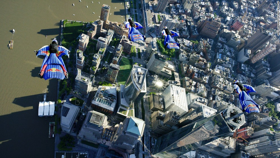 Members of the Red Bull Air Force -- Jon Devore, Jeff Provenzano, Amy Chmelecki and Sean MacCormac -- soar past One World Trade Center during a wingsuit flight in New York City on Sunday, May 18. It was the first time a wingsuit flight was permitted to take place over New York.