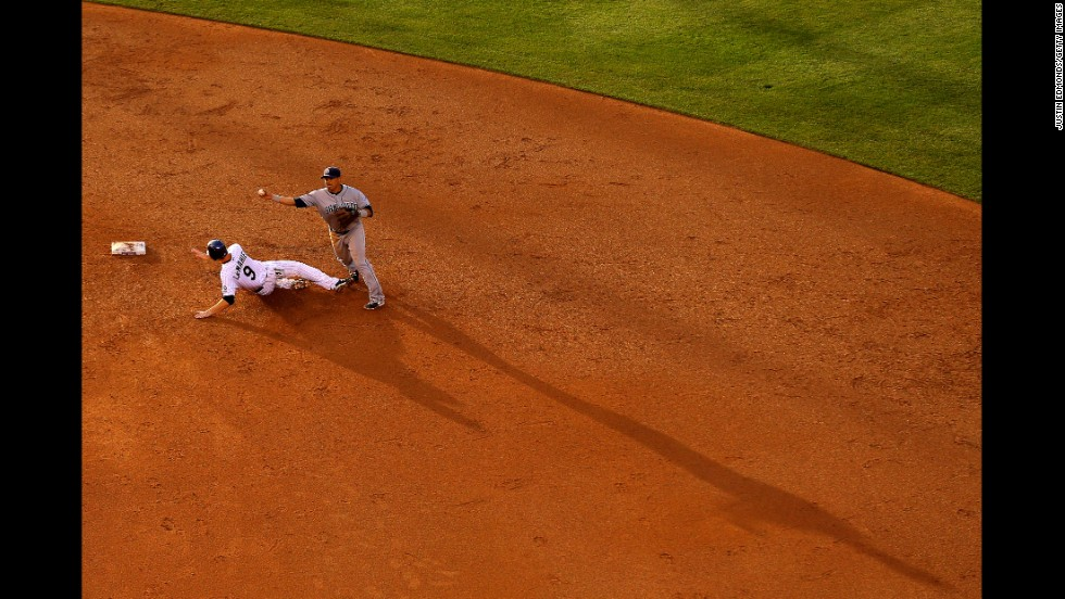 San Diego Padres shortstop Everth Cabrera avoids a sliding DJ LeMahieu to turn a double play in the Padres' 8-5 win over the Colorado Rockies on Saturday, May 17, in Denver.