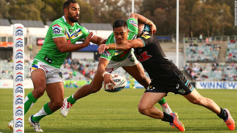 Jamie Soward of the Penrith Panthers attempts to tackle Anthony Milford of the Canberra Raiders before Milford scores a try during the National Rugby League match Sunday, May 18, in Canberra, Australia. Penrith won 26-20.