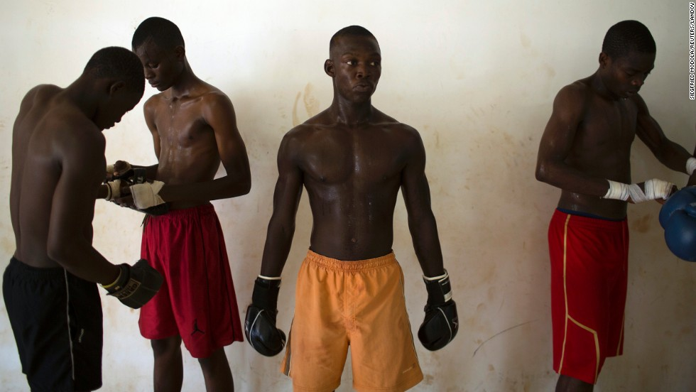Men take part in Thai boxing training Wednesday, May 14, at the Barthelemy Boganda Stadium in Bangui, Central African Republic.