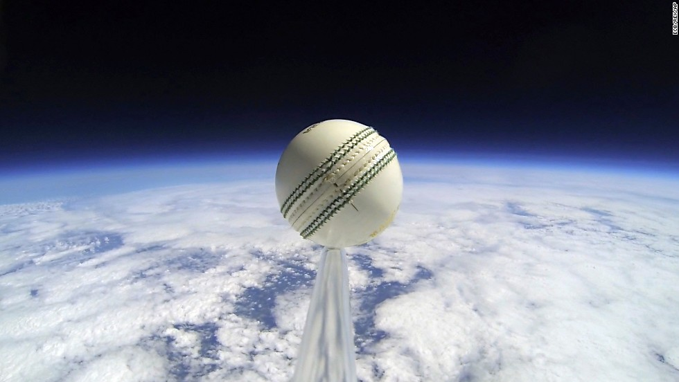 A cricket ball is seen on the edge of outer space after it was attached to a helium balloon and launched to an altitude of 110,000 feet -- approximately three times the cruising altitude of a commercial airplane. The England and Wales Cricket Board worked with a team of engineers for the launch, which announced the start of the NatWest T20 Blast competition on Friday, May 16. The ball landed safely back to Earth in near-perfect condition.
